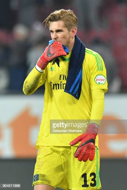 Julian Pollersbeck of Hamburg looks dejected after the Bundesliga match between FC Augsburg and Hamburger SV at WWKArena on January 13 2018 in...