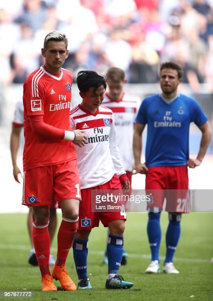 Julian Pollersbeck of Hamburger SV consoles Tatsuya Ito of Hamburger SV as their side are relegated after the Bundesliga match between Hamburger SV...