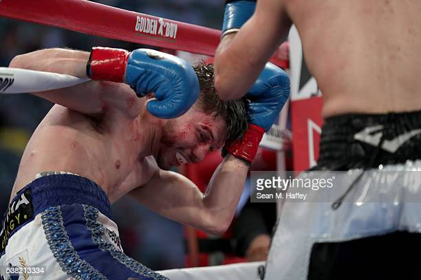 Julian Ramirez falls into the ropes after a punch by Abraham Lopez during their NABA featherweight title at StubHub Center on June 4 2016 in Carson...