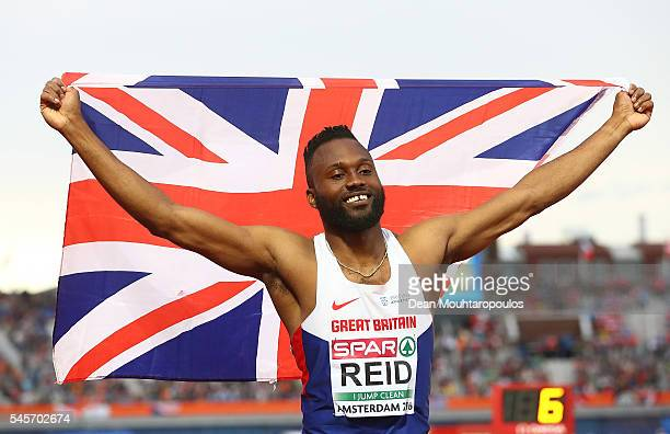 Julian Reid of Great Britain celebrates winning bronze in the men triple jump on day four of The 23rd European Athletics Championships at Olympic...