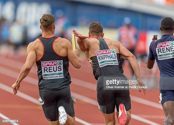 Julian Reus of Germany handing over to Sven Knipphals of Germany during the menÕs 4x100m relay finals at the Olympic Stadium during Day Five of the...