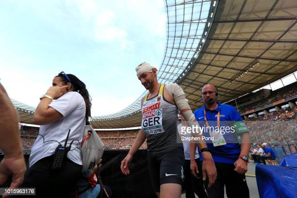 Julian Reus of Germany leaves the stadium with medical staff after falling in the Men's 4 x 100m Relay Round 1 Heat 2 during day six of the 24th...