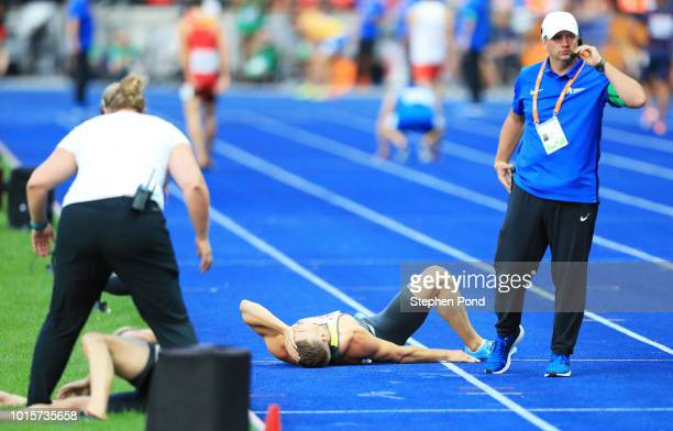Julian Reus of Germany lies on the ground after falling in the Men's 4 x 100m Relay Round 1 Heat 2 during day six of the 24th European Athletics...