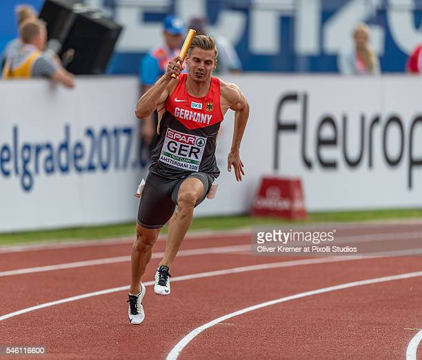 Julian Reus of Germany opening up the competition as start runner during the menÕs 4x100m relay finals at the Olympic Stadium during Day Five of the...