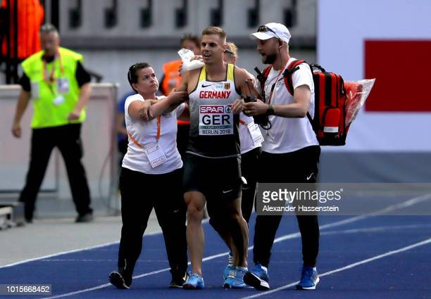 Julian Reus of Germany receives medical treatment after falling in the Men's 4 x 100m Relay Round 1 Heat 2 during day six of the 24th European...
