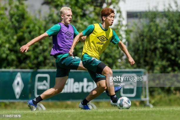Julian Rieckmann of SV Werder Bremen and Yuya Osako of SV Werder Bremen battle for the ball during a training session at the Werder Bremen training...