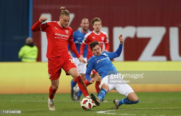 Julian Riedel of Rostock challenges for the ball with Sebastian Mai of Halle during the 3 Liga match between FC Hansa Rostock and Hallescher FC at...
