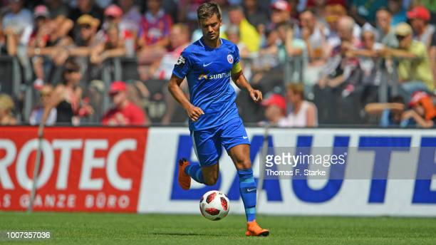 Julian Riedel of Rostock runs with the ball during the 3. Liga match between FC Energie Cottbus and F.C. Hansa Rostock at Stadion der Freundschaft on...