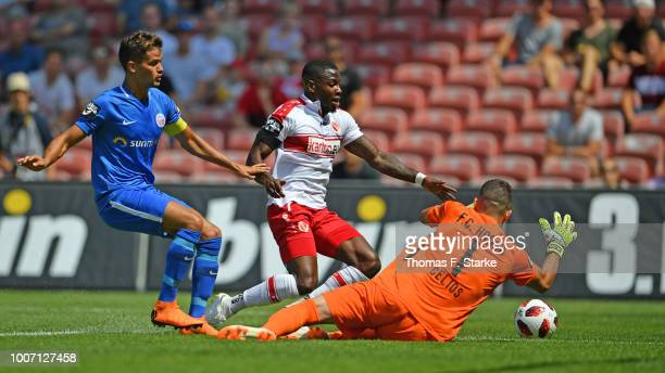 Julian Riedel of Rostock, Streli Mamba of Cottbus and Ioannis Gelios of Rostock fight for the ball during the 3. Liga match between FC Energie...