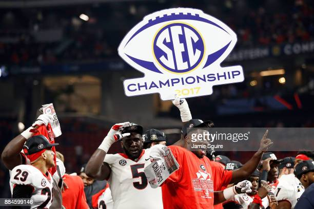 Julian Rochester of the Georgia Bulldogs and Lorenzo Carter celebrate beating the Auburn Tigers in the SEC Championship at MercedesBenz Stadium on...