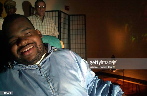 Julian Rodgers listens to jazz music as he moves back and forth in a rocking chair inside the 'multisensory room' at Elwyn Baring Street Center...