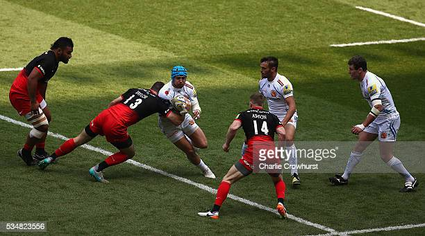 Julian Salvi of Exeter Chiefs is tackled by Duncan Taylor of Saracens during the Aviva Premiership final match between Saracens and Exeter Chiefs at...
