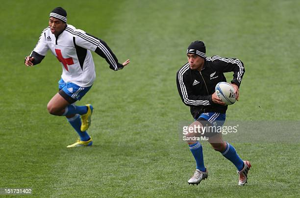 Julian Savea and Aaron Smith of the All Blacks in action during a New Zealand All Blacks training session at Forsyth Barr Stadium on September 11,...