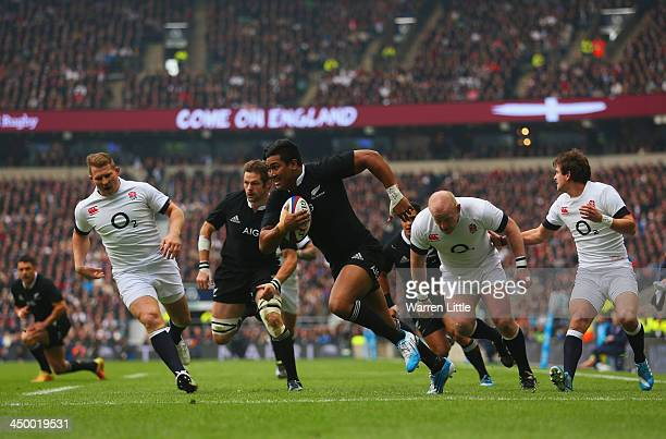 Julian Savea of New Zealand breaks through the England defense to score the opening try during the QBE International match between England and New...
