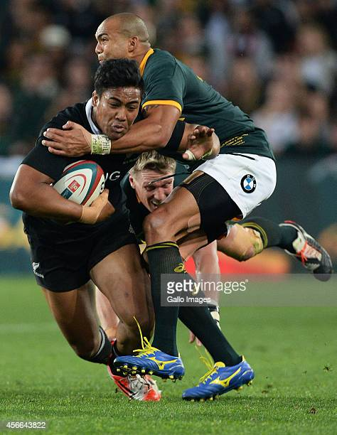 Julian Savea of New Zealand gets tackled by Cornal Hendricks of South Africa during The Castle Rugby Championship match between South Africa and New...