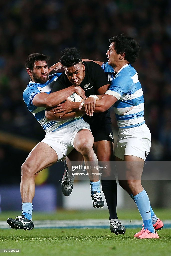 Julian Savea of New Zealand is tackled by Matias Orlando and Matias Moroni of Argentina during the Rugby Championship match between the New Zealand All Blacks and Argentina at Waikato Stadium on September 10, 2016 in Hamilton, New Zealand.