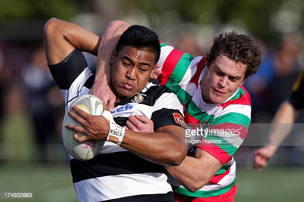 Julian Savea of OrientalRongotai is tackled by Reuben Colquhoun of Hutt Old Boys Marist during the Jubilee Cup Semi Final match between...