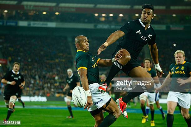 Julian Savea of the All Blacks and Cornal Hendricks of the Springboks contest the high ball during The Rugby Championship match between the New...