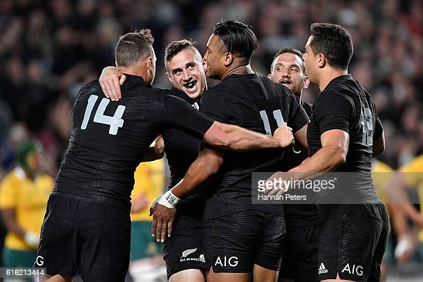 Julian Savea of the All Blacks celebrates a try with TJ Perenara Israel Dagg Aaron Cruden and Anton LienertBrown of the All Blacks during the...