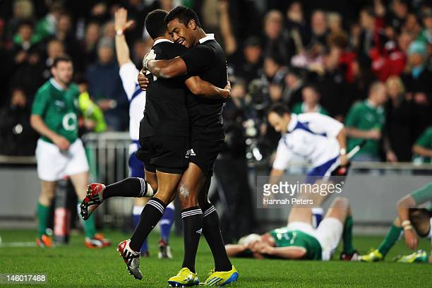 Julian Savea of the All Blacks celebrates with Aaron Smith after scoring a try during the International Test Match between the New Zealand All Blacks...