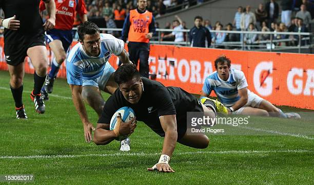Julian Savea of the All Blacks dives over for his second try during the Rugby Championship match between Argentina and the New Zealand All Blacks at...