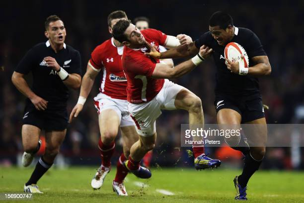 Julian Savea of the All Blacks fends off Alex Cuthbert of Wales during the international match between Wales and New Zealand at Millennium Stadium on...