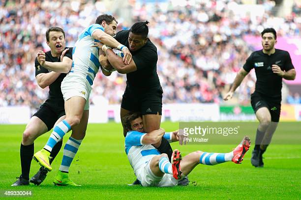 Julian Savea of the All Blacks is tackled during the 2015 Rugby World Cup Pool C match between New Zealand and Argentina at Wembley Stadium on...