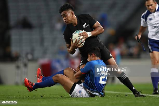 Julian Savea of the All Blacks is tackled during the International Test match between the New Zealand All Blacks and Samoa at Eden Park on June 16,...
