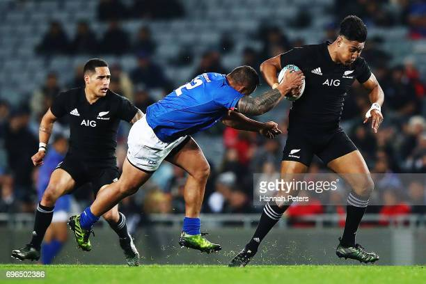 Julian Savea of the All Blacks makes a break during the International Test match between the New Zealand All Blacks and Samoa at Eden Park on June 16...