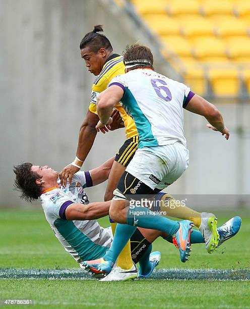 Julian Savea of the Hurricanes beats the tackle of Francois Venter of the Cheetahs during the round five Super Rugby match between the Hurricanes and...