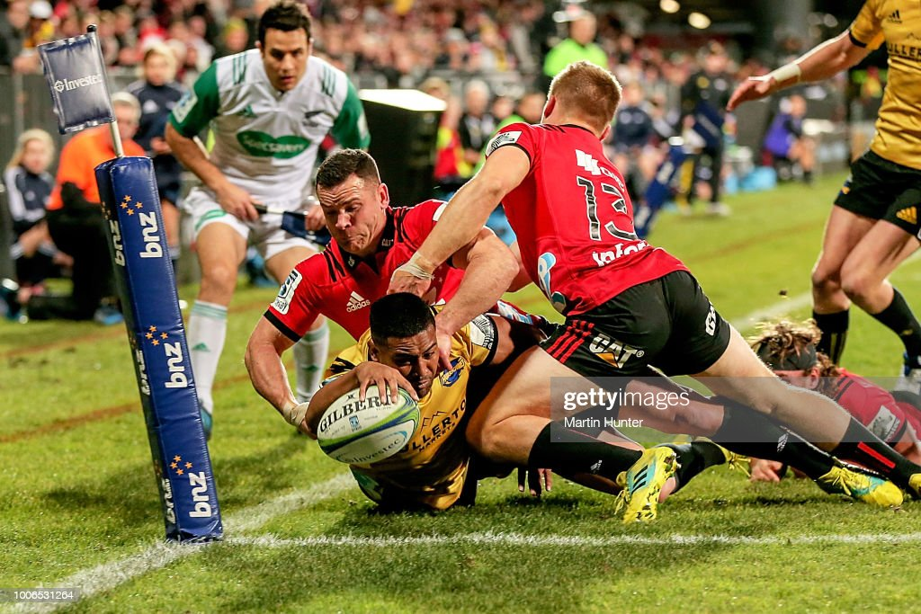 Julian Savea of the Hurricanes breaks through the tackle of Ryan Crotty and Jack Goodhue of the Crusaders to score a try during the Super Rugby Semi Final match between the Crusaders and the Hurricanes at AMI Stadium on July 28, 2018 in Christchurch, New Zealand.