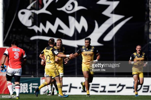 Julian Savea of the Hurricanes celebrates with teammates after scoring a try during the Super Rugby Rd 1 game between Sunwolves and Hurricanes at...
