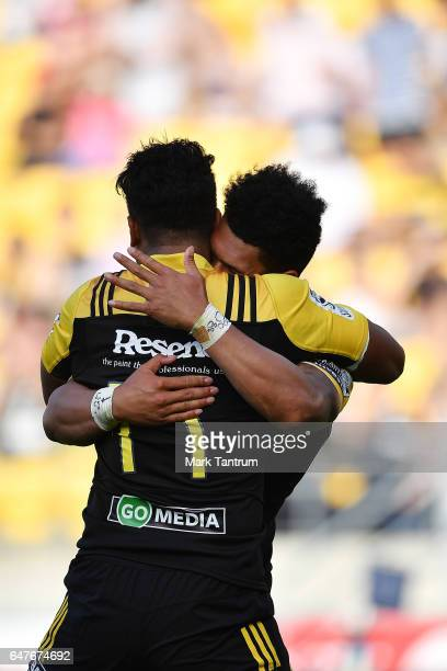 Julian Savea of the Hurricanes congratulates Ardie Savea of the Hurricanes during the round two Super Rugby match between the Hurricanes and the...