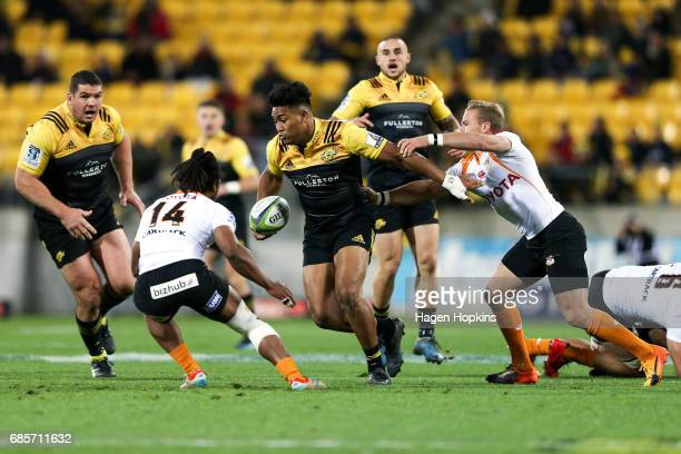 Julian Savea of the Hurricanes fends Fred Zeilinga of the Cheetahs during the round 13 Super Rugby match between the Hurricanes and the Cheetahs at...
