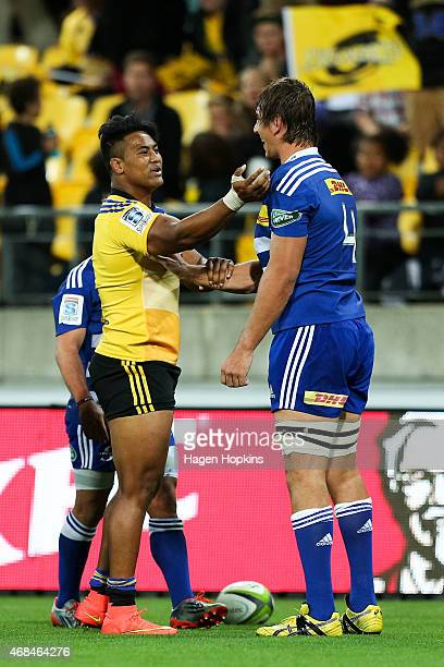 Julian Savea of the Hurricanes has an exchange with Eben Etzebeth of the Stormers during the round eight Super Rugby match between the Hurricanes and...
