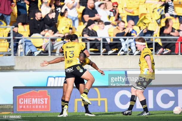 Julian Savea of the Hurricanes is congratulated by team mates after scoring a try during the round seven Super Rugby Aotearoa match between the...