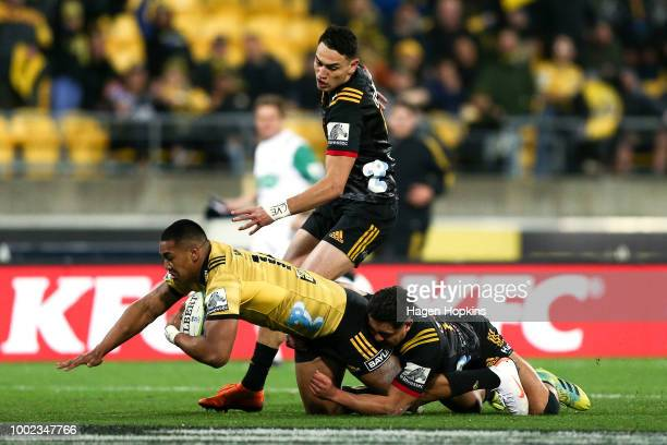 Julian Savea of the Hurricanes is tackled by Anton LienertBrown of the Chiefs during the Super Rugby Qualifying Final match between the Hurricanes...