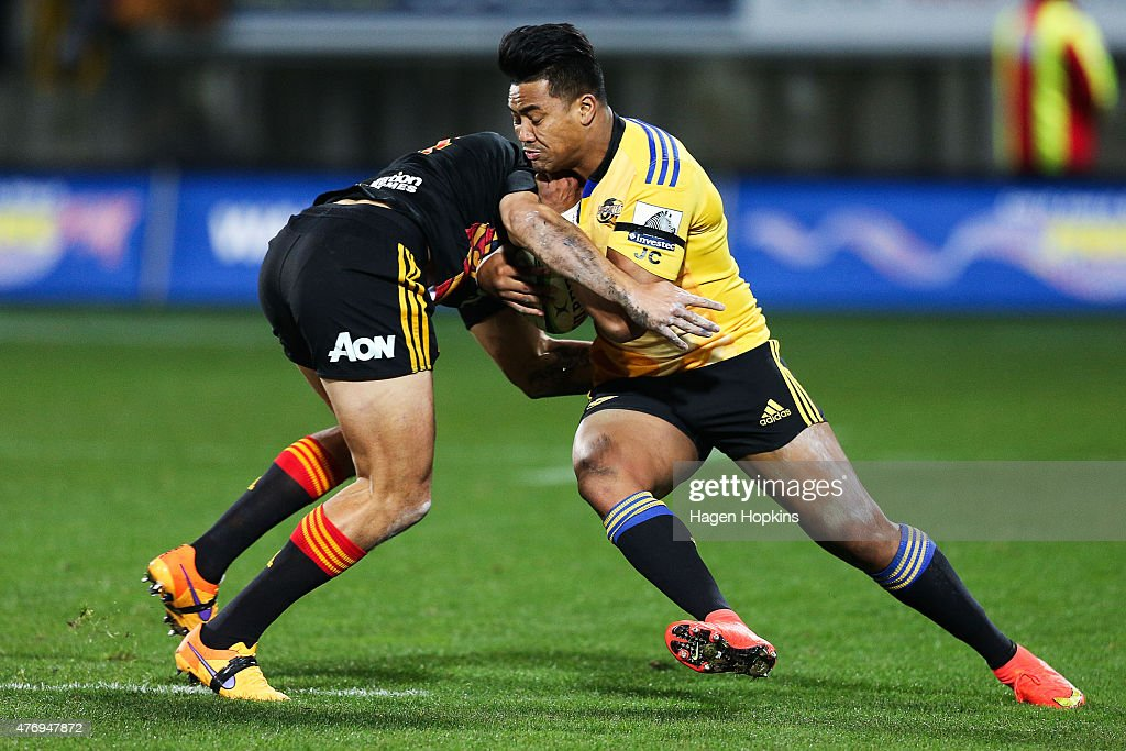 Julian Savea of the Hurricanes is tackled by Bryce Heem of the Chiefs during the round 18 Super Rugby match between the Chiefs and the Hurricanes at Yarrow Stadium on June 13, 2015 in New Plymouth, New Zealand.