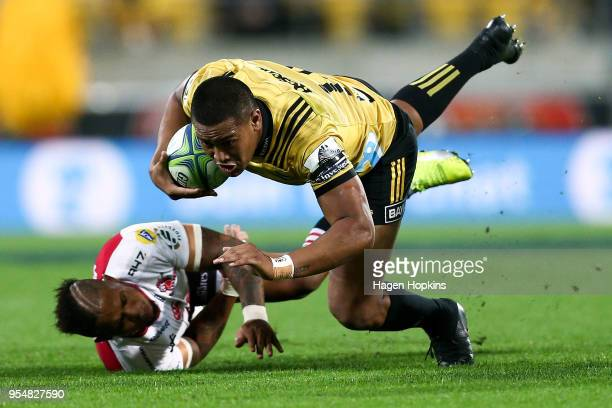 Julian Savea of the Hurricanes is tackled by Elton Jantjies of the Lions during the round 12 Super Rugby match between the Hurricanes and the Lions...