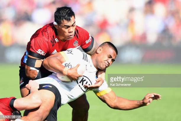 Julian Savea of the Hurricanes is tackled by Michael Alaalatoa of the Crusaders during the round two Super Rugby Aotearoa match between the Crusaders...