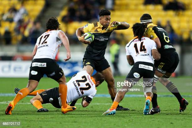 Julian Savea of the Hurricanes is tackled by Niel Marais of the Cheetahs during the round 13 Super Rugby match between the Hurricanes and the...