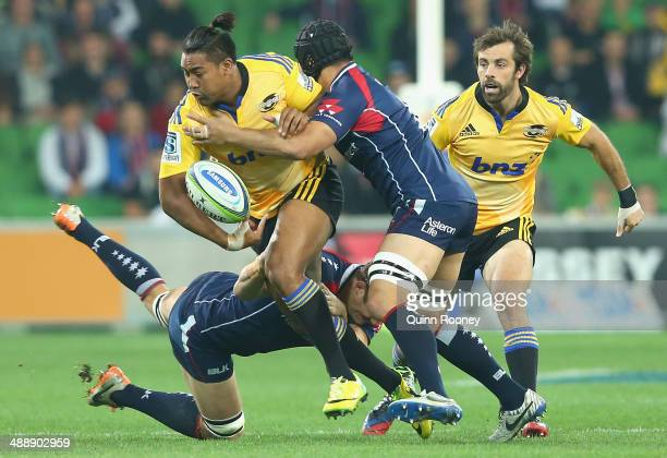 Julian Savea of the Hurricanes is tackled by Scott Higginbotham of the Rebels during the round 13 Super Rugby match between the Rebels and the...