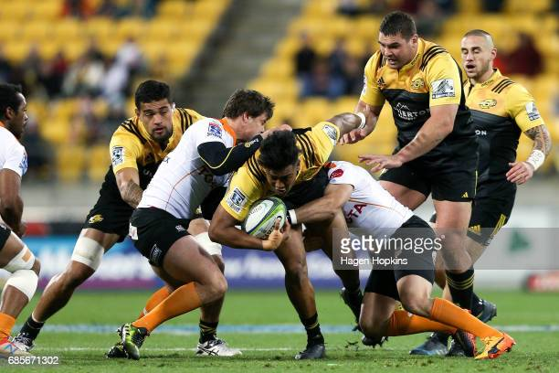 Julian Savea of the Hurricanes is tackled during the round 13 Super Rugby match between the Hurricanes and the Cheetahs at Westpac Stadium on May 20...