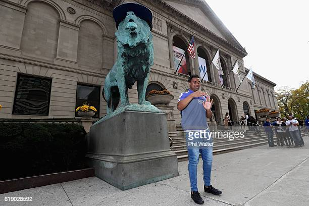 Julian Savea of the New Zealand All Blacks dances along with a street busker in the Chicago CBD on October 29 2016 in Chicago Illinois The All Blacks...