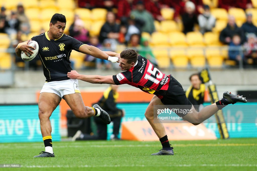 Julian Savea of Wellington beats the tackle of George Bridge of Canterbury during the round five Mitre 10 Cup match between Wellington and Canterbury at Westpac Stadium on September 17, 2017 in Wellington, New Zealand.