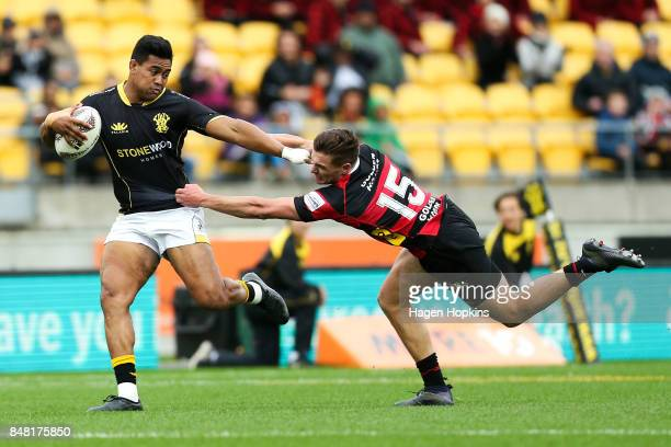 Julian Savea of Wellington beats the tackle of George Bridge of Canterbury during the round five Mitre 10 Cup match between Wellington and Canterbury...