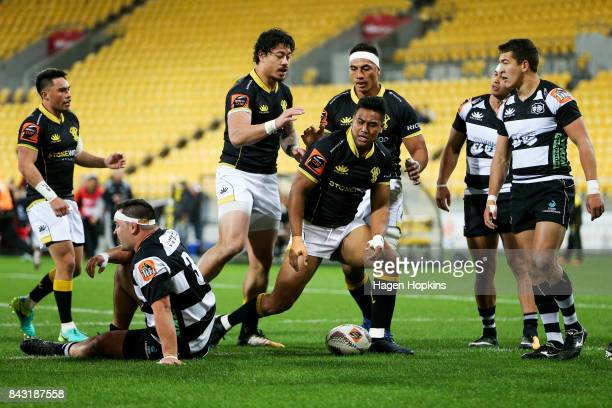 Julian Savea of Wellington celebrates his try with teammate Ben Lam during the round four Mitre 10 Cup match between Wellington and Hawke's Bay at...