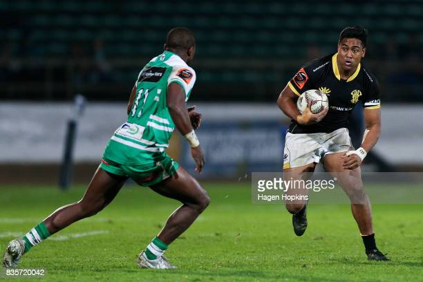 Julian Savea of Wellington looks to beat the challenge of Willy Ambaka of Manawatu during the round one Mitre 10 Cup match between Manawatu and...