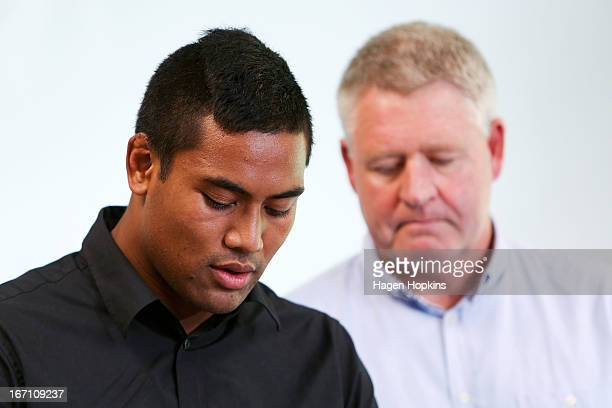 Julian Savea reads a statement to media about his assault charge while NZRU CEO Steve Tew looks on during a press conference at Rugby League Park on...