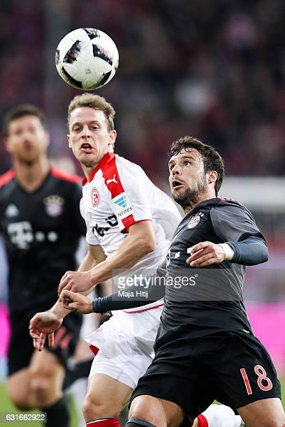 Julian Schauerte of Duesseldorf and Juan Bernat of Bayern fight for the ball during the Telekom Cup 2017 match between Fortuna Duesseldorf and Bayern...